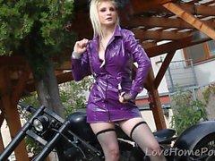 Sensational biker girl gets completely naked on camera