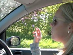 Hayley M smokes while driving