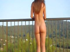 Killer bum teasing on the balcony
