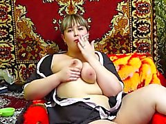 smokes and masturbates. Russian beautiful plump by a pussy hairy