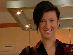 Sweet Czech brunette Emylia Argan bares her boobs in the kitchen