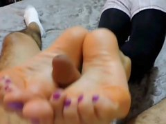 Sexy Colombian reverse footjob with purple toes