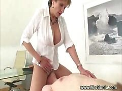 Prodomme working her slaves cock before facesitting