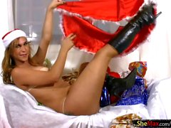 Teen tranny Santa in black boots whips out cock and balls