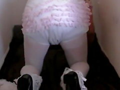 Diapered sissybaby peeing pantyhose gets double diapers
