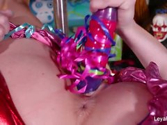 Clown Leya Falcon plays with a big purple dildo