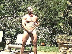 Hairy bear Brad lounges by the pool and starts feeling horny
