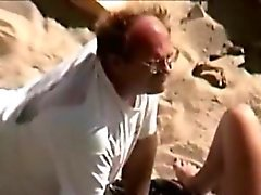 Man eats pussy in the beach