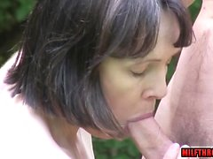 Brunette milf outdoor with cum on ass