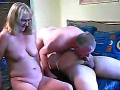 Mature couple with younger man