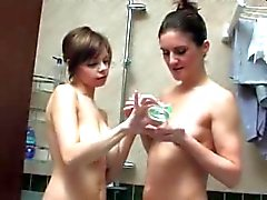 Busty girl and MILF playing in the bathroom