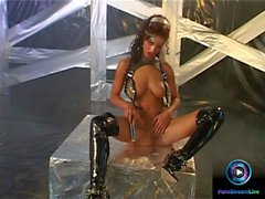 Fucking the brunette Angel Dark in a leather suit