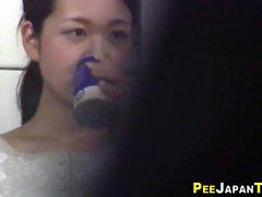 Asian babe filmed pissing