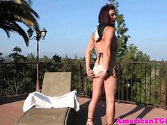 Busty tattooed tgirl pees outdoors after wank