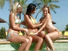 Sensual brunette and blonde lesbians licking and fingering pussies in a three way lesbian orgy