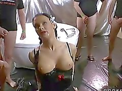 Busty brunette swallowing bodily fluids hard
