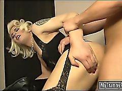 Kinky blonde tranny sucks off thru gloryhole and gets banged