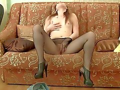Smoking hot Kleo is masturbating her crotch on the sofa
