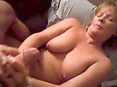 Big breasted mature housewife puts her hands to work on a h