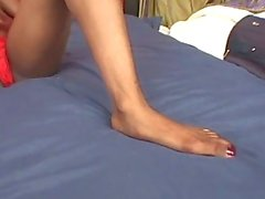 Black foot fetish slut toying her own pussy and cock torture by leg
