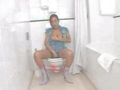 Asian tranny masturbates on toilet sink