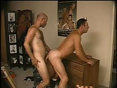 Bald headed hunk gives his gay lover a hard anal drilling from behind