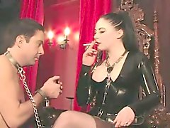 Smoking latex femdom plays with her manslave