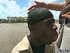 Thug sucks a big white cock outdoors