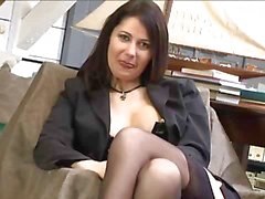 Busty brunette in black stockings posing