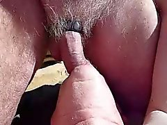 nat feeds ray cock at the beach