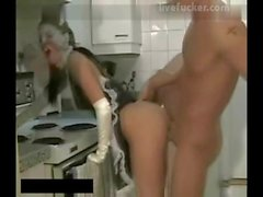 Maid gets her pussy fucked in the kitchen