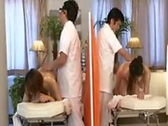Two sexy Asian girls enjoy a hot massage and feed their lus