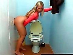 Blonde gives blowjob through toilet gloryhole
