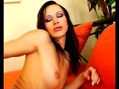 Classy brunette in high heels Susana Spears drives her slit to climax