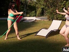 Busty lesbians play with a hose