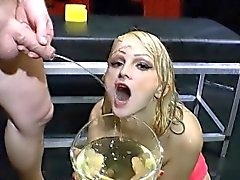 Slut chugs urine bowl