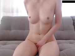 Georgia Jones licks her fingers after jerking off