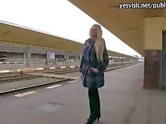 kinky gal flashes boobs and fucks at a train station
