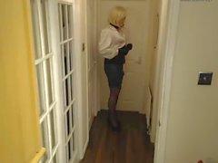 Candi in secretary style, satin blouse and pvc shiny skirt
