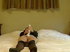 Susan masturbates on bed