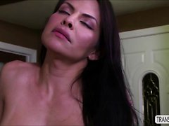 Latina TS Foxxy slobbers huge dick