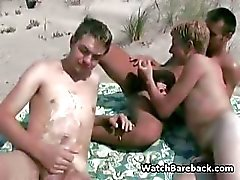 Gay threesome beach blowjob