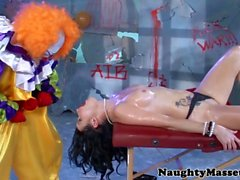 Tattooed deepthroating babe fucked by a clown