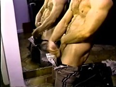 Lustful guy pulls his pants down and masturbates in front of a mirror