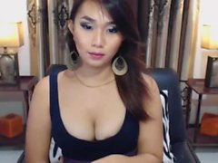 Pretty Shemale Plays her Big Cock