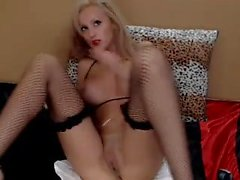 Buxom blonde in fishnet stockings fucks herself with a dild