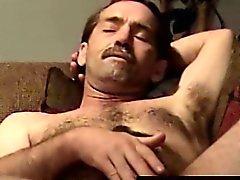 Masturbating hairy biker getting sucked