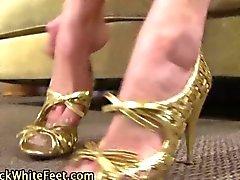 Whtie feet jerk off a fat African wiener