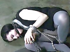 Restrained slave receives torture for her wicked fur pie