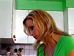 Beautiful mom and boy in the kitchen